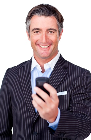 Happy businessman sending a text  photo