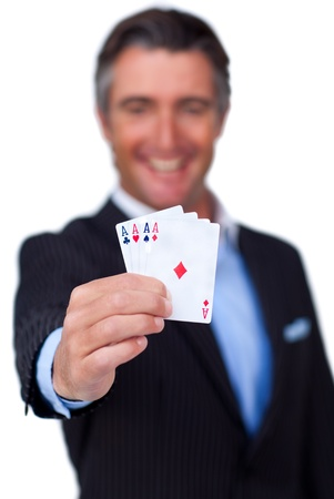 Happy businessman holding a white card  photo