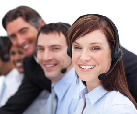 Portrait of a businesswoman and her team working in a call center Stock Photo - 10078208