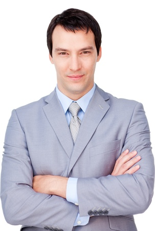 Confident businessman with folded arms photo