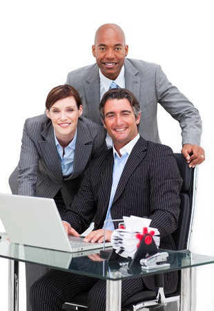Self-assured business team working at a computer photo