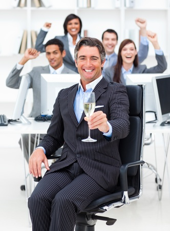 fortunate: Fortunate manager and his team drinking champagne Stock Photo