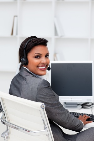 Businesswoman with headset on at work photo