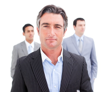Charming businessman posing in front of his team photo