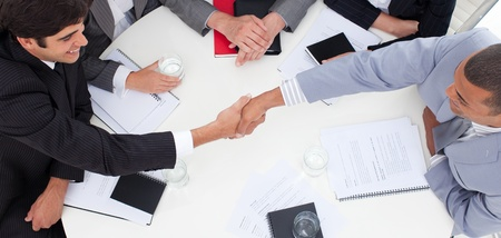 Close-up of successful business people closing a deal  photo