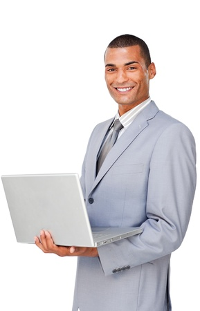 Smiling Confident businessman using a laptop  photo