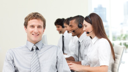 Attractive manager with his team Stock Photo - 10092832