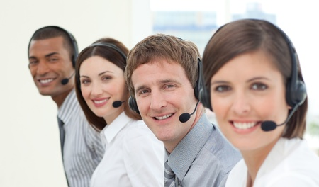 Smiling customer service agents with headset on Stock Photo - 10076488