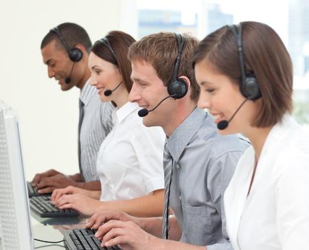 Concentrated customer service agents working in a call center Stock Photo - 10078197