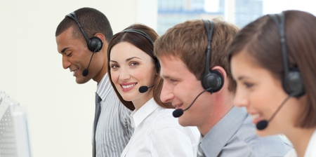 Young business people with headset on Stock Photo - 10076047