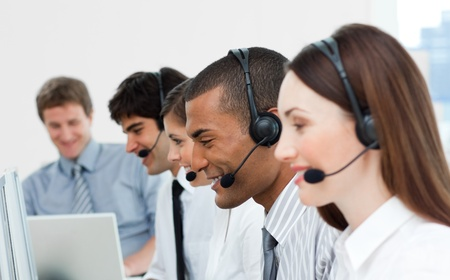 Multi-ethnic customer service agents in a call center photo