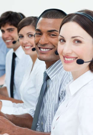 Customer service agents smiling at the camera  Stock Photo - 10075986