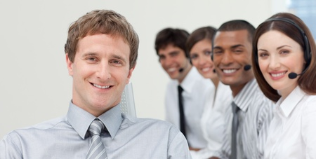 Manager and his team smiling at the camera Stock Photo - 10076530