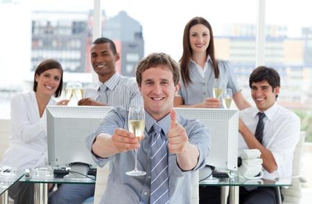 competitive business: Competitive business team drinking champagne
