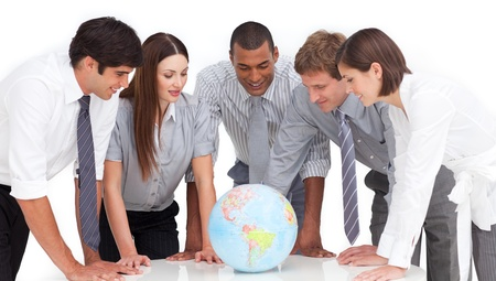 A meeting of business team around a terrestrial globe photo