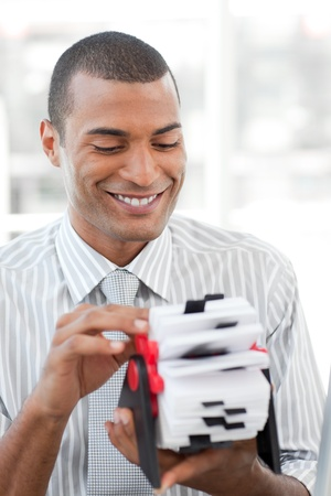 Attractive businessman consulting a business card holder photo