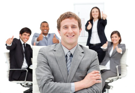 male's thumb: International business people with thumbs up