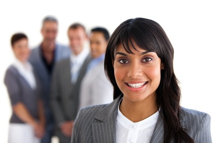 foreground: Focus on an ethnic young manager  Stock Photo