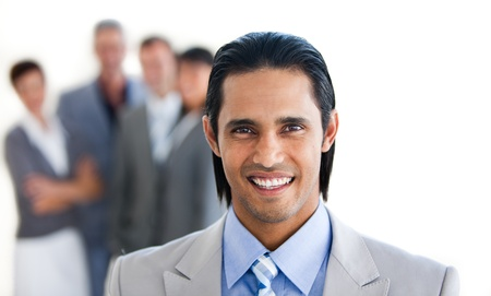 Charismatic businessman in front of his team Stock Photo - 10092903