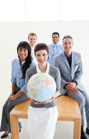 businessmeeting: Multi-ethnic business people holding a terrestrial globe  Stock Photo