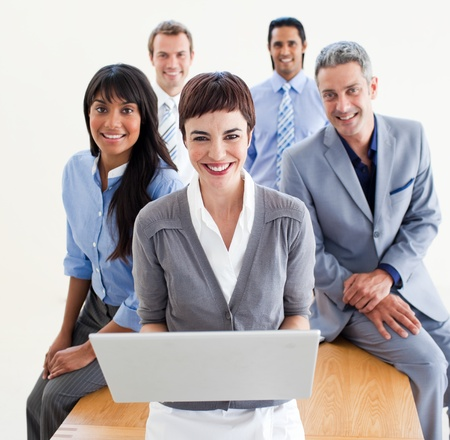 Enthusiastic business people using a laptop  photo