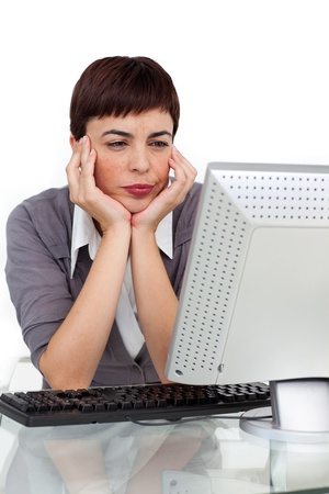 Bored businesswoman looking at her computer  Stock Photo - 10097157