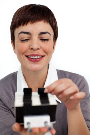 Confident businesswoman consulting a business card holder  photo