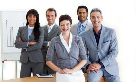 Confident multi-ethnic business people around a conference table  photo