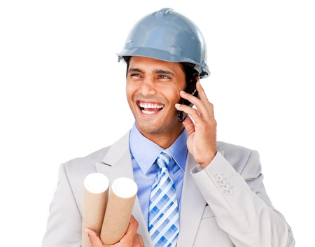 Confident businessman wearing a hardhat on phone photo