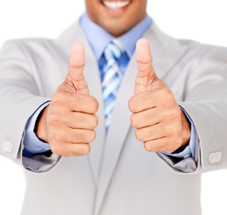 Close-up of a businessman with thumbs up in celebration photo