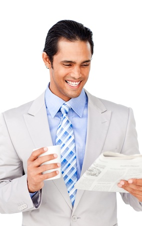 economic downturn: Attractive asian businessman driking coffee and reading a newspaper