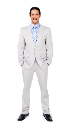 Smiling businessman with hands in pockets photo