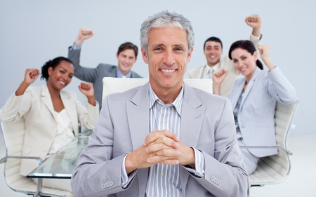 sucess: Happy manager and business team celebrating a sucess