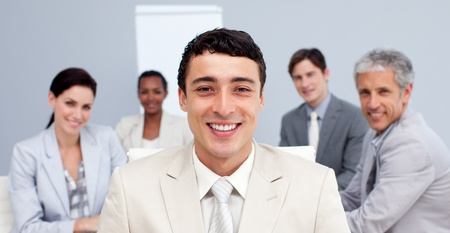 Smiling businessman leading his team in a meeting photo