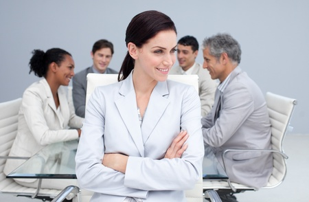 Beautiful businesswoman smiling in a meeting photo