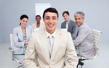 Young businessman smiling in a meeting photo