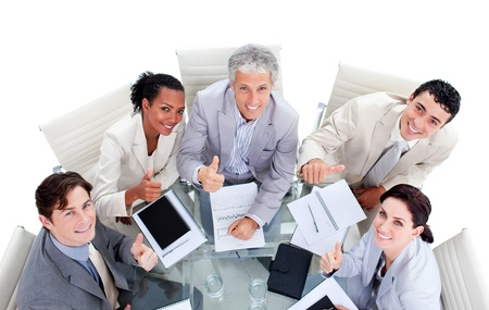 Successful multi-ethnic business team with thumbs up photo