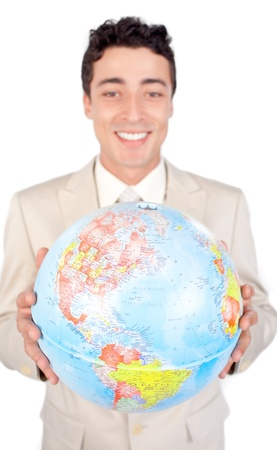 online internet presence: Assertive male executive holding a terrestrial globe