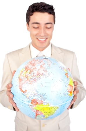 online internet presence: Positive male executive looking at a globe   Stock Photo