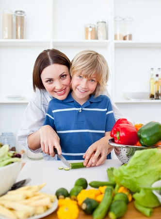 Caring mother and her son cooking  Stock Photo - 10097189