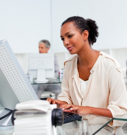 Concentrated businesswoman working at a computer Stock Photo - 10095537