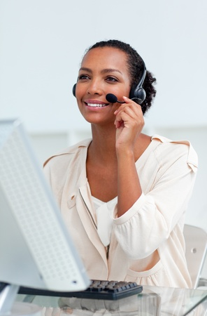 Positive businesswoman with headset on  photo