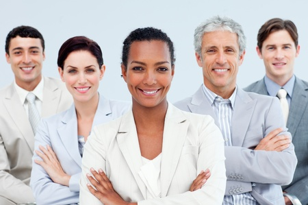 Diverse business people standing with folded arms  photo