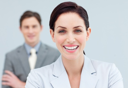 assertive: Cheerful business people standing in a row  Stock Photo