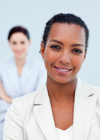 Positive international business people standing photo