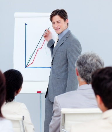 Young businessman doing a presentation photo