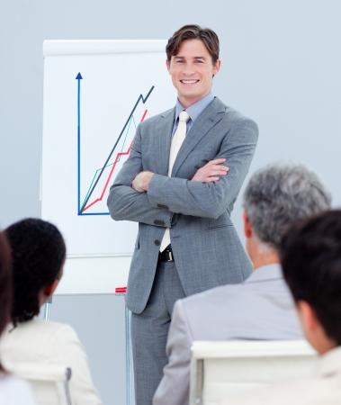Confident businessman reporting sales figures Stock Photo - 10097002