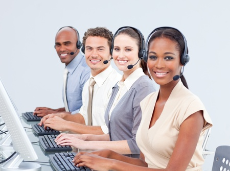 Multi-ethnic customer service representatives using headset photo