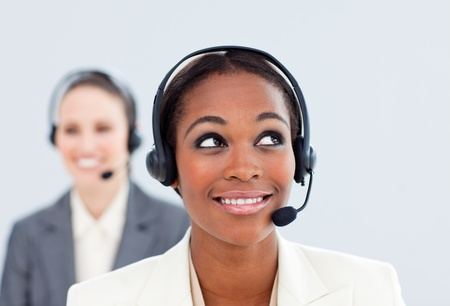Charismatic businesswoman and her colleague with headset on photo