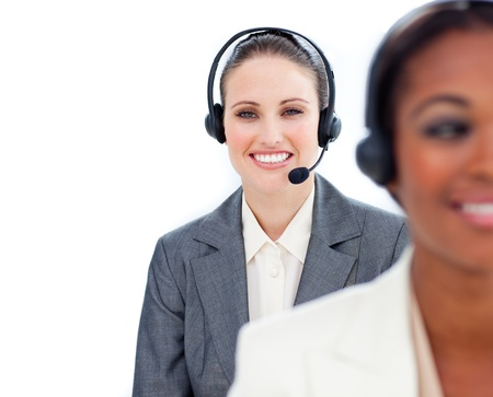 Portrait of young businesswoman and her colleague with headset on  photo